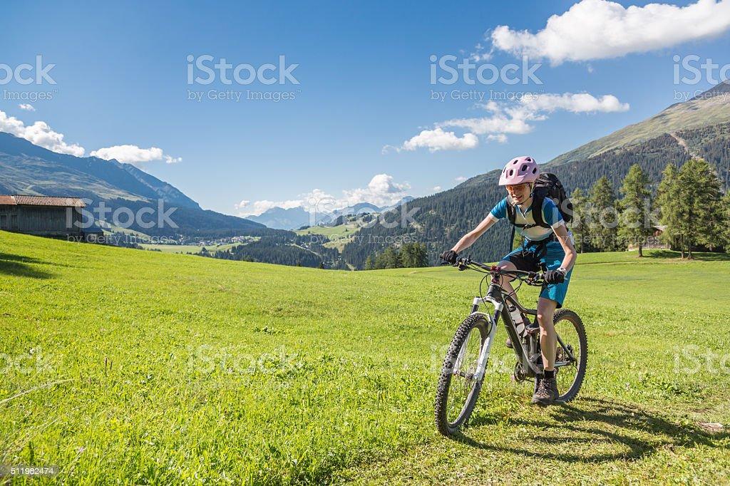 Graubünden grass biking, Switzerland stock photo