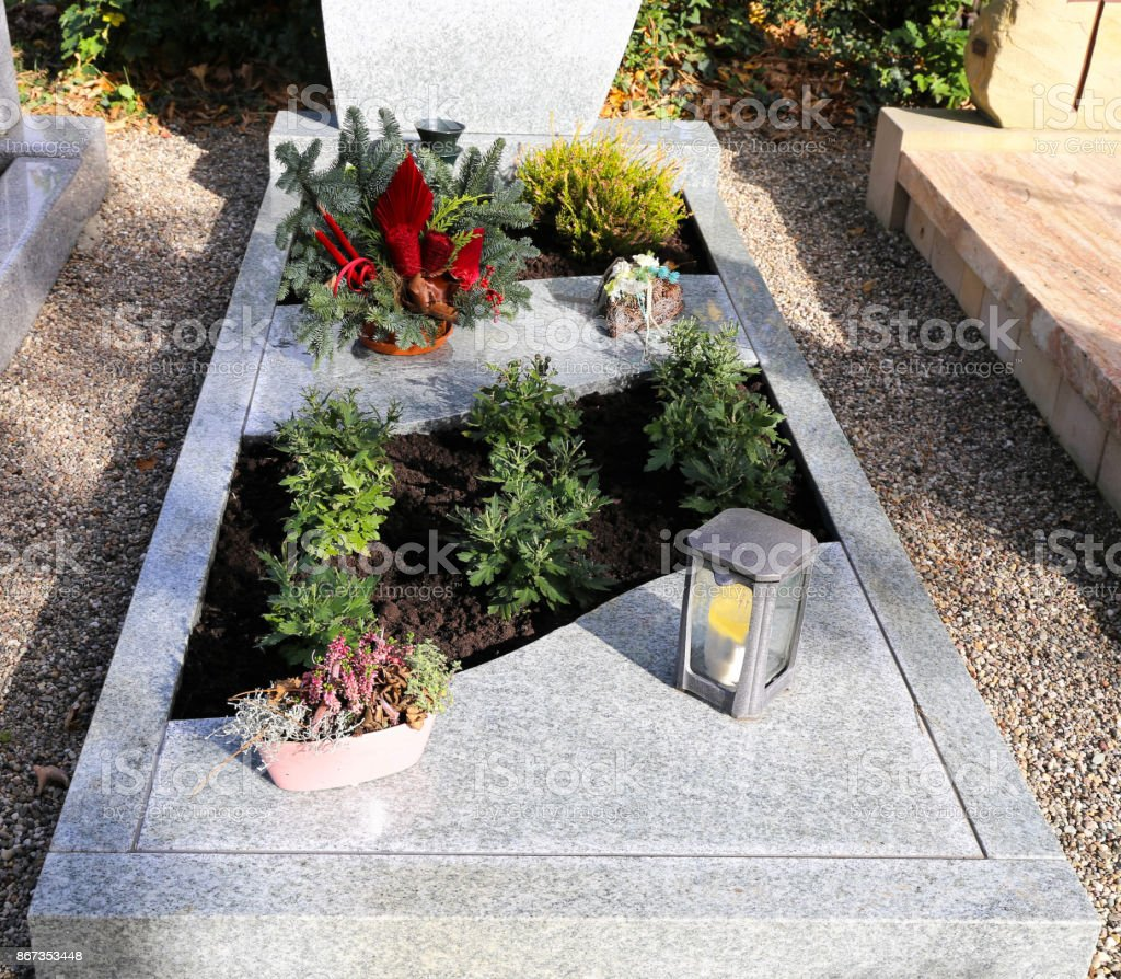 Grave design on a christian cemetery stock photo