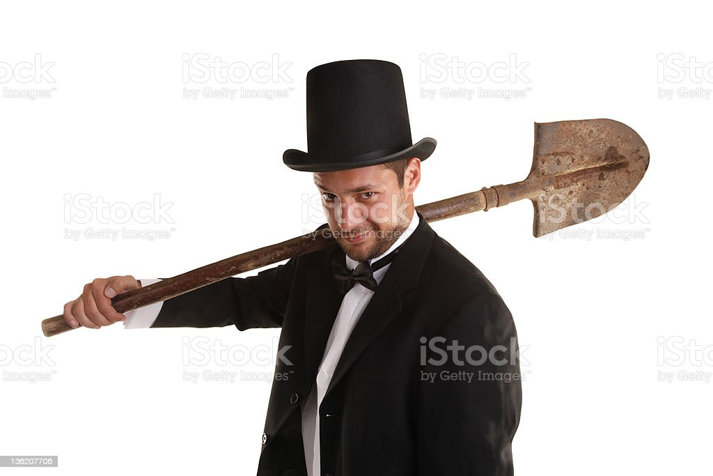 Grave Digger with dirty spade This is a spooky grave digger. Adult Stock Photo