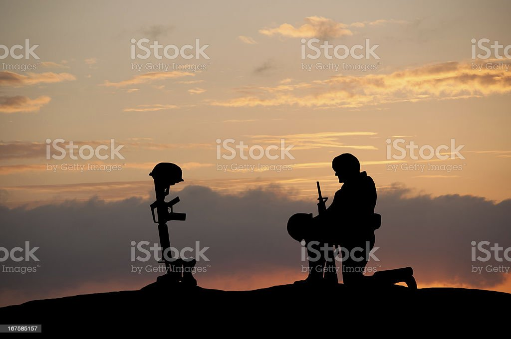 Image result for soldier kneeling at a grave