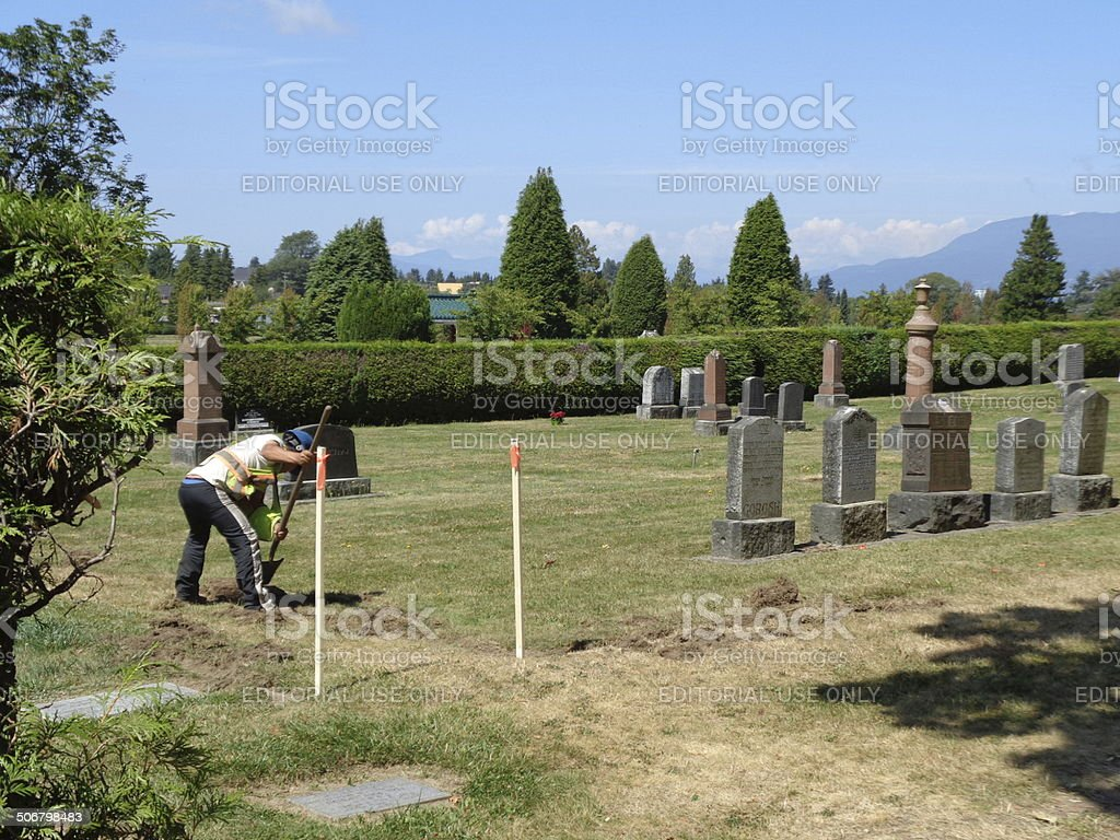 Gravedigger at work stock photo