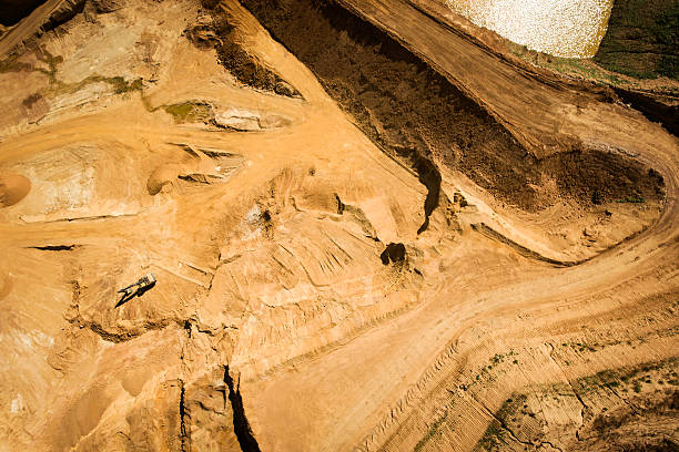 gravel and sand quarry - aerial view - aerial view soil germany stock-fotos und bilder