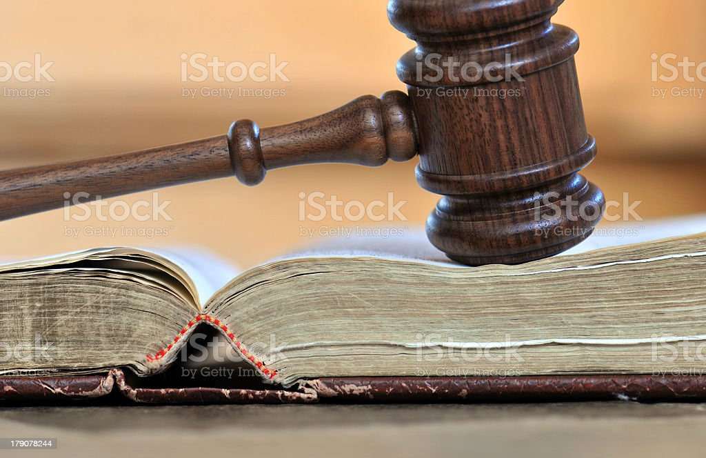 Gravel on a book depicting judgment day stock photo