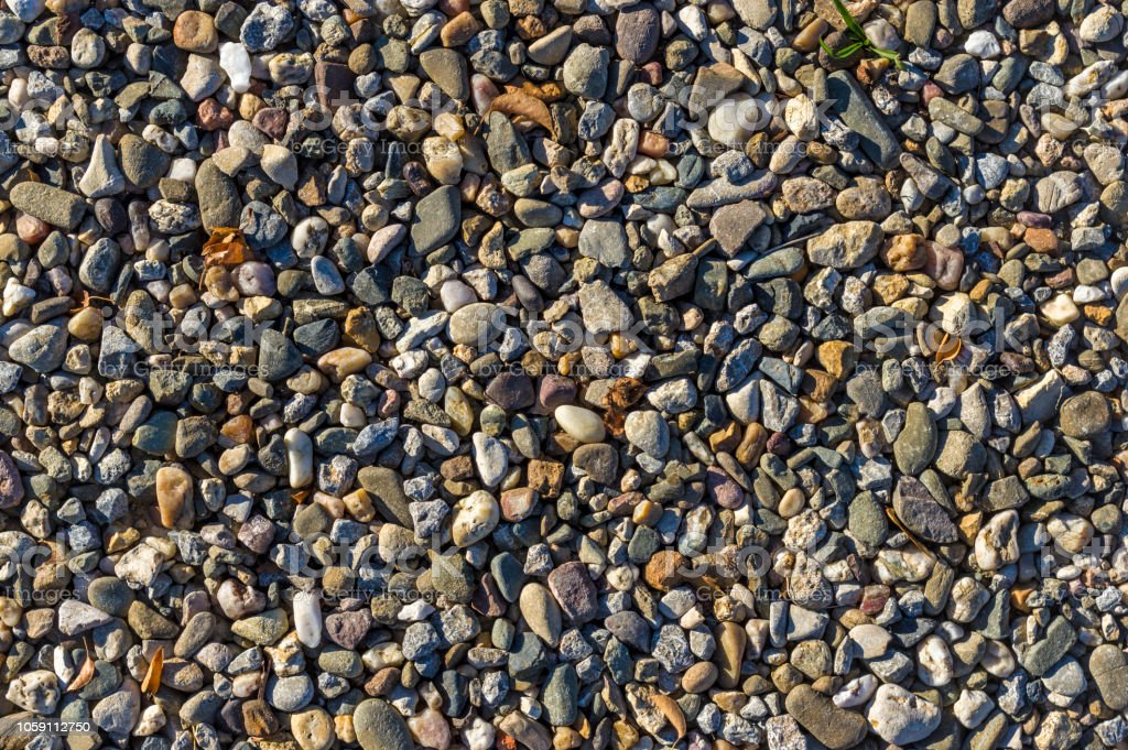 Gravel, pebbles as way fastening, natural flooring, drainage, building materials, gardening and landscaping, aggregates, building materials trade, gravel stock photo
