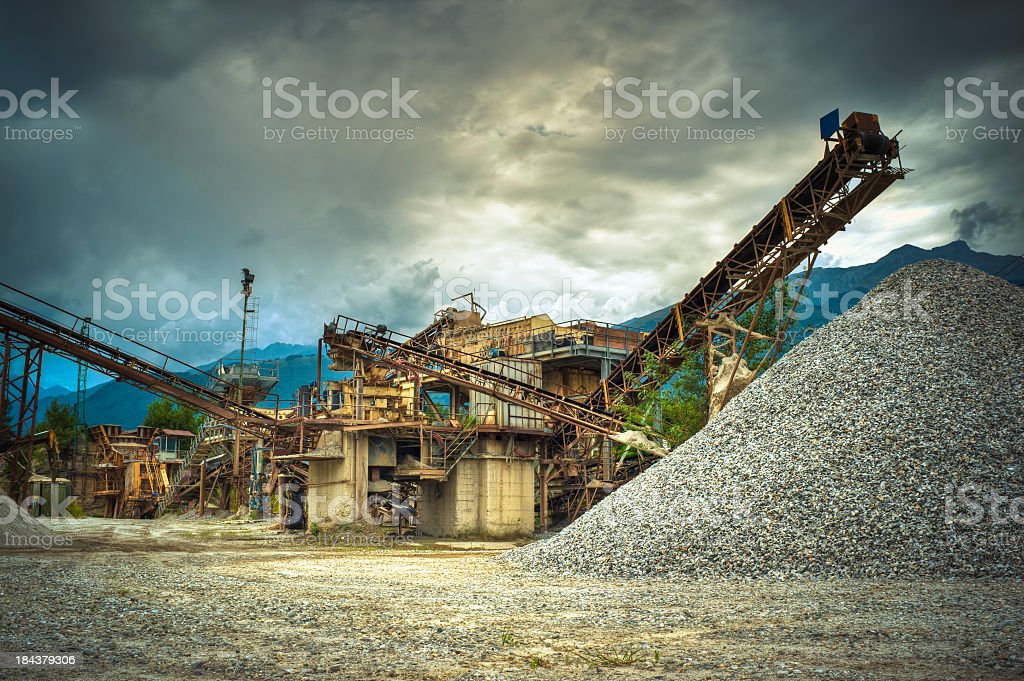 Gravel Piles And Factory Against Cloudscape, HDR royalty-free stock photo