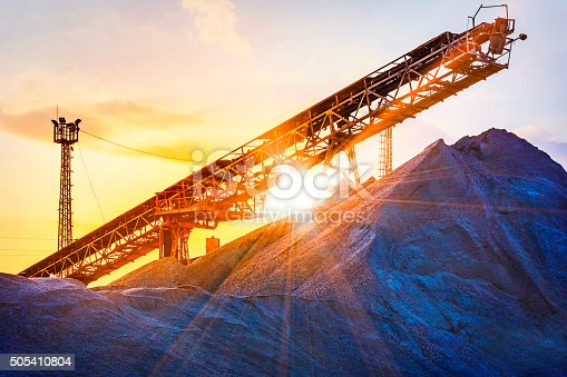 gravel pit with an industrial gravel sorter machinery with beautiful sunburst color effect