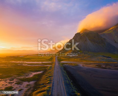 istock Gravel road at sunset with Vestrahorn mountain in the background, Iceland 1309892946