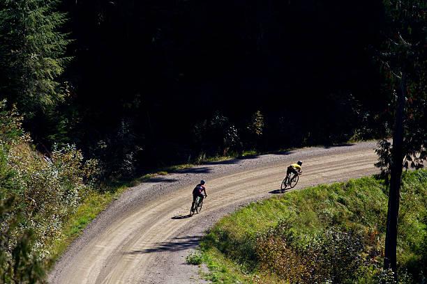 gravel road bike ride - cyclocross stock-fotos und bilder