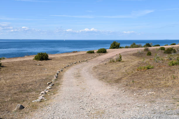 Gravel road by the coast stock photo