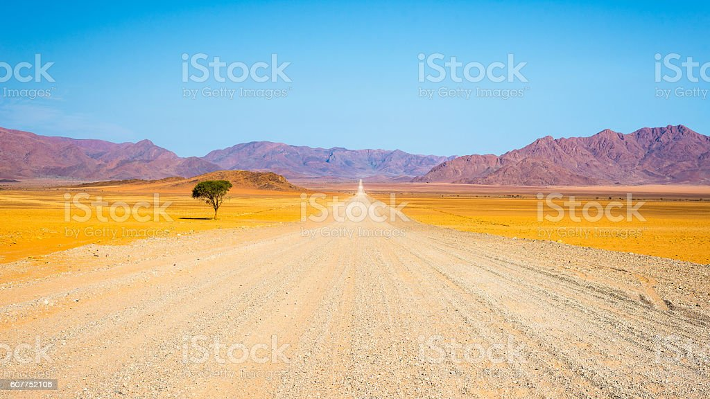 Gravel road crossing the Namib desert, Namibia, Africa - Photo