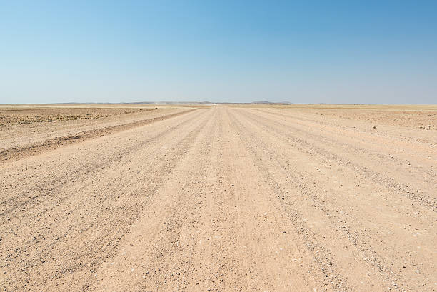 Gravel road crossing the Namib desert, Namibia, Africa stock photo