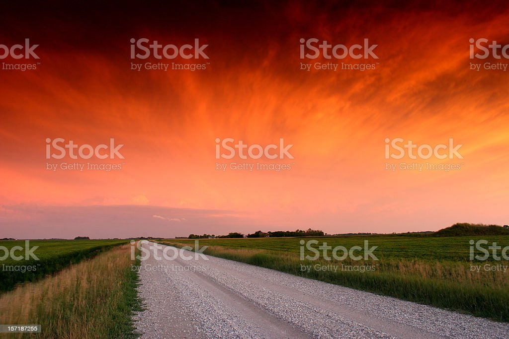 Gravel Road in the Midwest with Dramatic Sunset stock photo