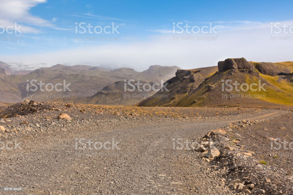 Gravel Road through Icelandic Lava mountains stock photo