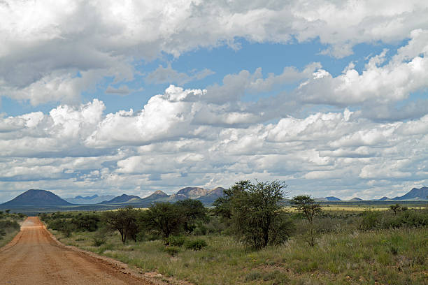 Gravel road with distant mountains stock photo
