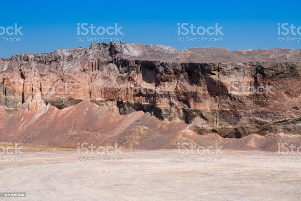 Gravel stone dumps in a quarry open pit mining. Processing plant for crushed stone and gravel. Mining and Quarry mining material. stock photo