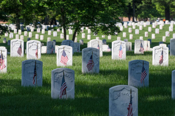 graves from the time of the spanish american war are marked with u.s. flags for memorial day at arlington national cemetery, may 26, 2014. - arlington national cemetery stock pictures, royalty-free photos & images