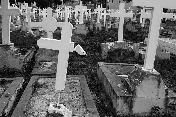 Graves with crosses in a abandoned cemetery stock photo