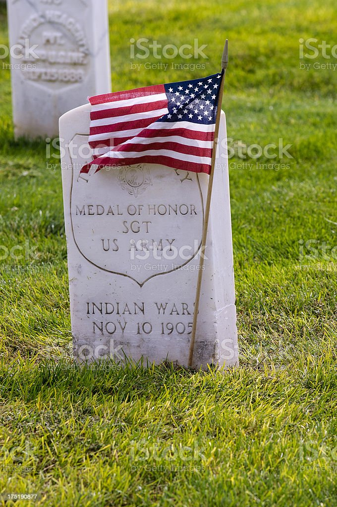 Gravestone and US flag stock photo