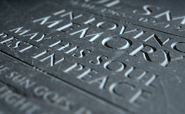 Gravestone In Loving Memory A 3D render of closeup of a carved and etched tombstone highlighting the word in loving memory carving craft product stock pictures, royalty-free photos & images