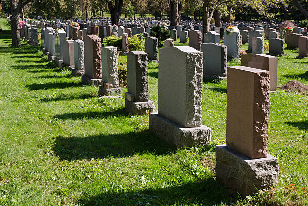 gravestones in an american cemetery - cemetery stock photos and pictures