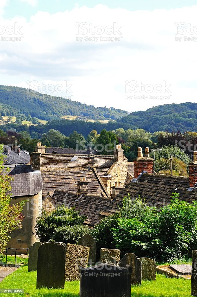 Graveyard and cottage rooftops, Bakewell. stock photo