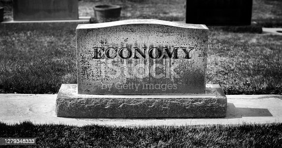 istock Graveyard and headstone or grave stone with economy carved as the name 1279348333
