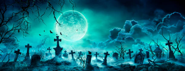 Graveyard At Night - Spooky Cemetery With Moon In Cloudy Sky And Bats stock photo