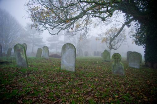 Graveyard with tombstones and fog