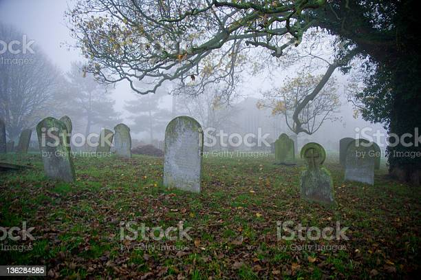 Graveyard With Tombstones And Fog Stock Photo - Download Image Now