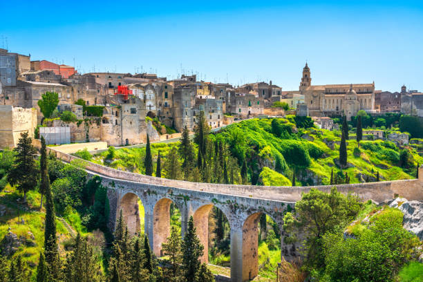 Gravina in Puglia ancient town, bridge and canyon. Apulia, Italy. Gravina in Puglia ancient town, bridge and canyon. Apulia, Italy. Europe matera italy stock pictures, royalty-free photos & images