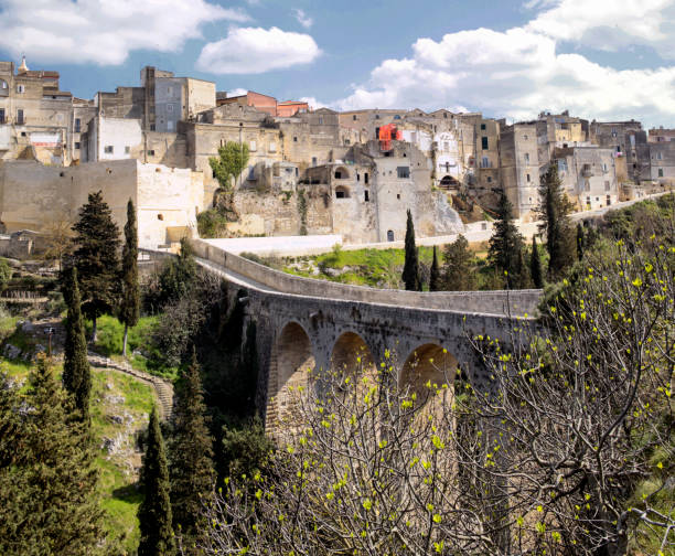 Gravina in Puglia Gravina di Puglia, Bari, Italy - March 28,2017:The Via Appia, which linked Rome to Brindisi, passed through Gravina. The Itineraries place it 20 miles from Venusia, on the branch of the Appian Way which led direct to Tarentum. mattock stock pictures, royalty-free photos & images