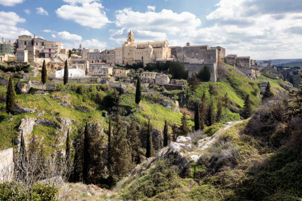 Gravina in Puglia Gravina di Puglia, Bari, Italy - March 28,2017:The Cathedral on the gravina, hill top.The word gravina comes from the Latin grava or from the messapic graba, with the meaning of rock, shaft and erosion of bank river. Also the town is the home of the Alta Murgia National Park. mattock stock pictures, royalty-free photos & images