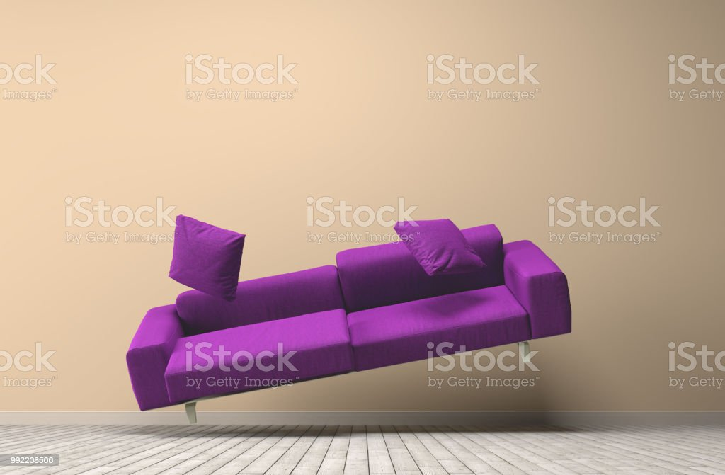 Gravity concept purpe couch stock photo