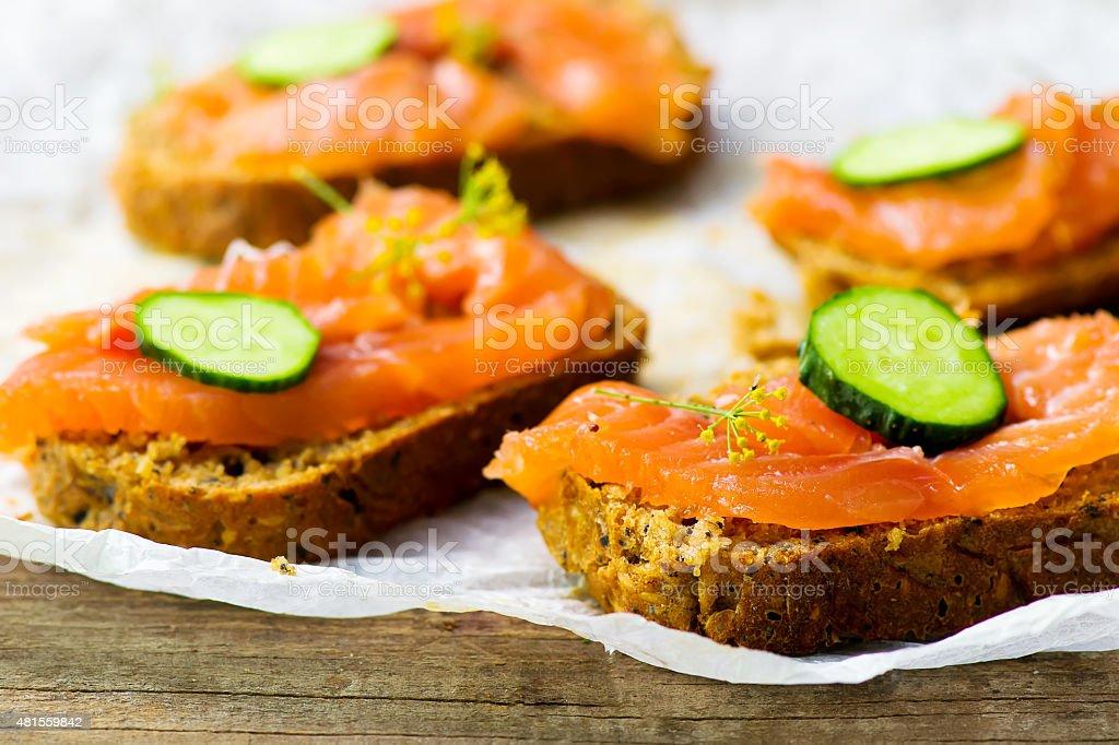 gravlax on bread with bran stock photo