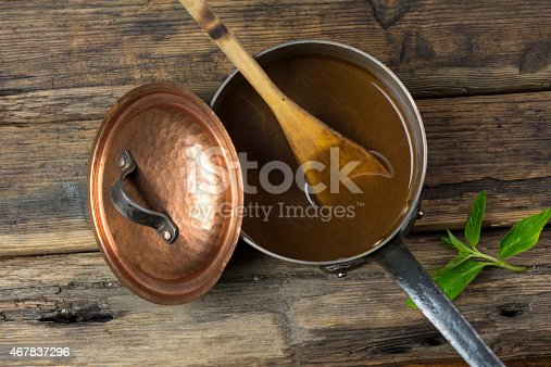 Gravy in a copper pot top view