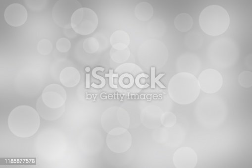 530427918 istock photo Gray abstract texture background with white bokeh light Christmas new year snowflake blurred beautiful shiny lights use wallpaper backdrop and your product. 1185877576