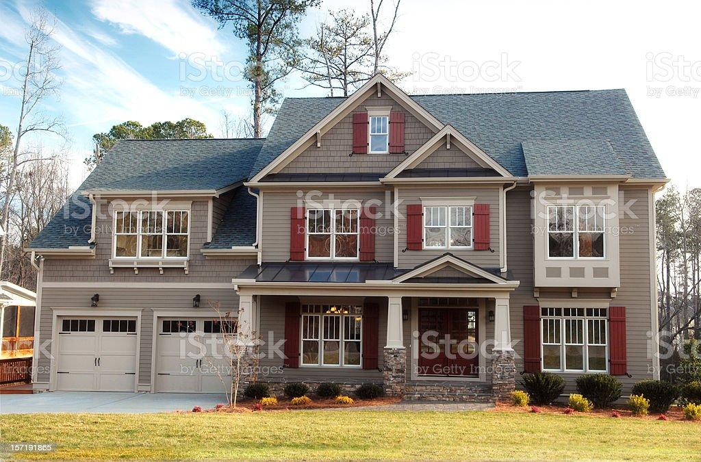 A gray accented suburban home with a double garage stock photo
