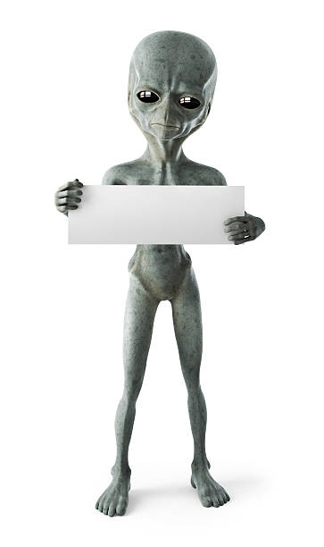 A gray alien with a blank sign on a white background stock photo