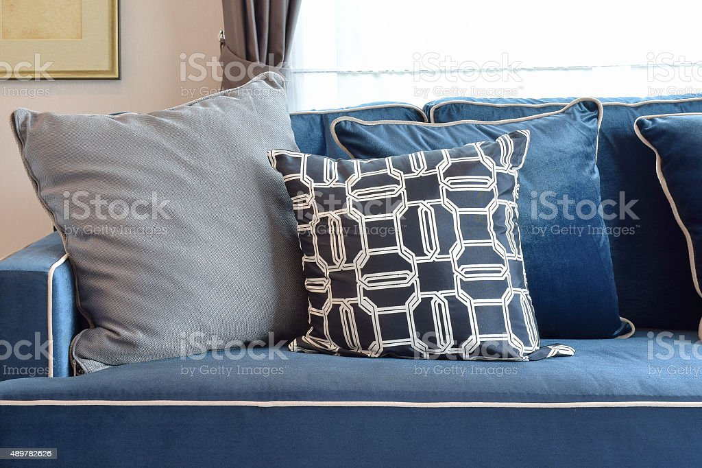 gray and blue pillow setting up on classic sofa stock photo