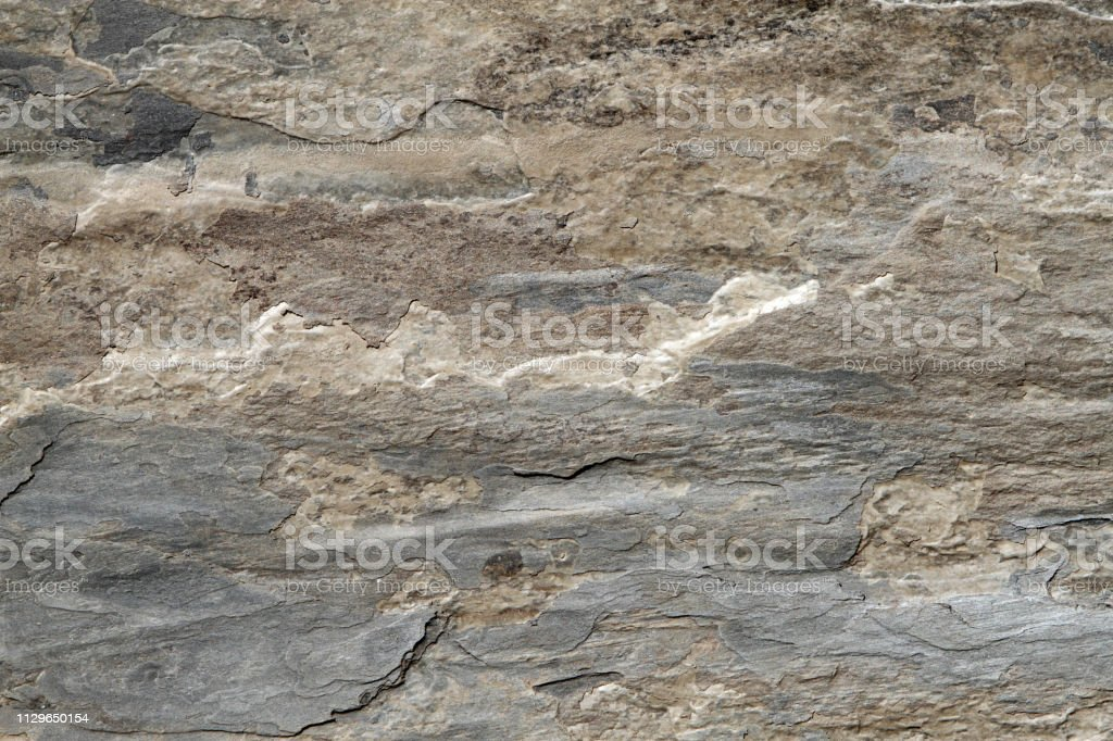 gray and brown slate stone background stock photo