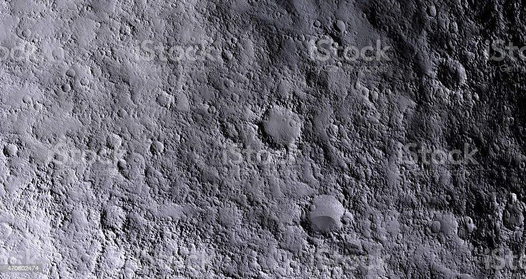 Gray and rocky surface of the moon stock photo