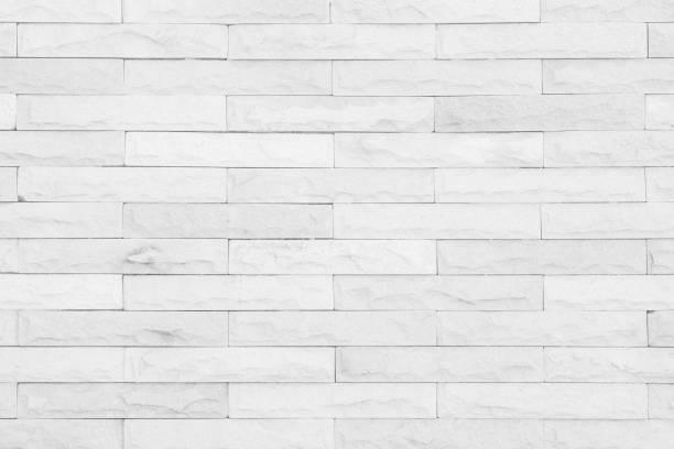 grauer und weißer ziegelwand-textur-hintergrund. - badezimmer new york style stock-fotos und bilder