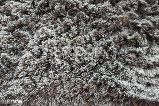 Black and white colored Fluffy Background.Shaggy fur texture. Fur skins for sheepskin skins for interior design