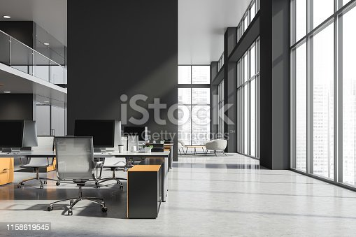 Gray open space office interior with large windows, concrete floor, white computer tables and white metal chairs. Lounge area with armchairs in background. 3d rendering