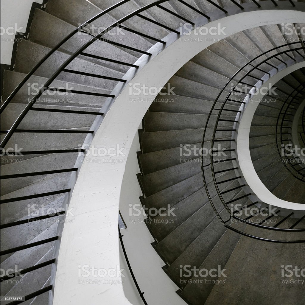 Gray and white spiral staircase as seen from the top royalty-free stock photo