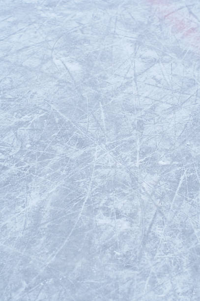 Gray and white toned ice background ice background for skating and hockey - shallow dof focus in the middle  ice rink stock pictures, royalty-free photos & images