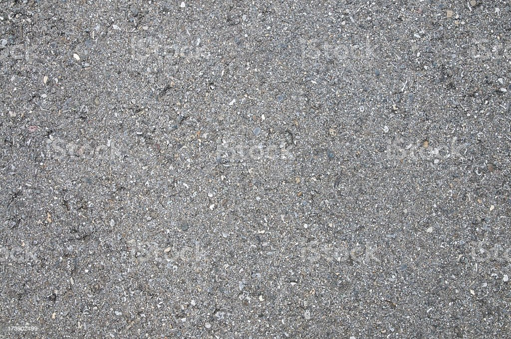 Gray asphalt with crystals and diamonds imbedded stock photo