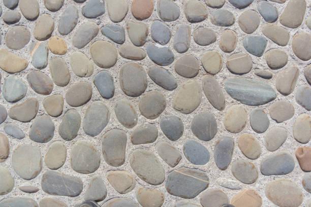Cтоковое фото Gray background of cobblestone pavement