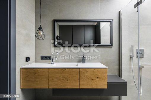istock Gray bathroom with countertop basin 695273880