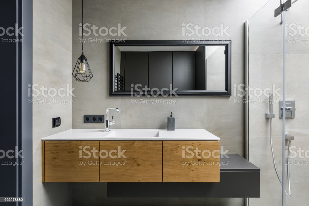 Gray bathroom with countertop basin stock photo